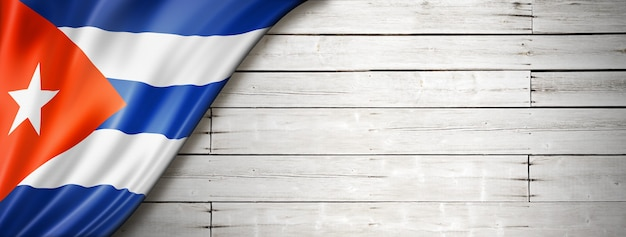 Cuba flag on old white wall