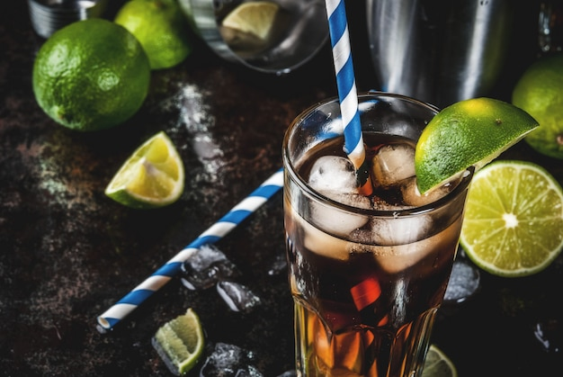 Cuba libre, long island or iced tea cocktail with strong alcohol, cola, lime and ice, two glass