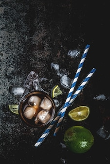 Cuba libre, long island or iced tea cocktail with strong alcohol, cola, lime