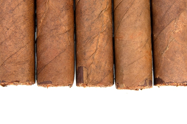 Cuban cigars isolated on white surface