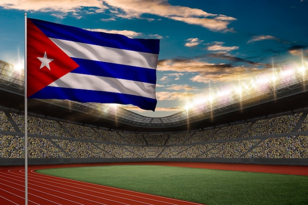 Cuban flag in front of a track and field stadium with fans.
