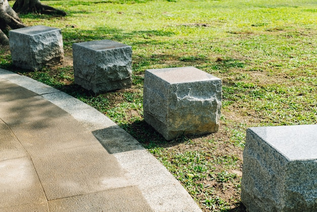 Cube stone seats in the park in the area of national dr.