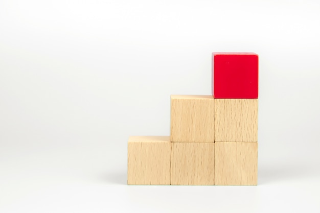 Cube wooden block toy stacked without graphics for business design, concept and build activity for children play create and practices foundation stage.