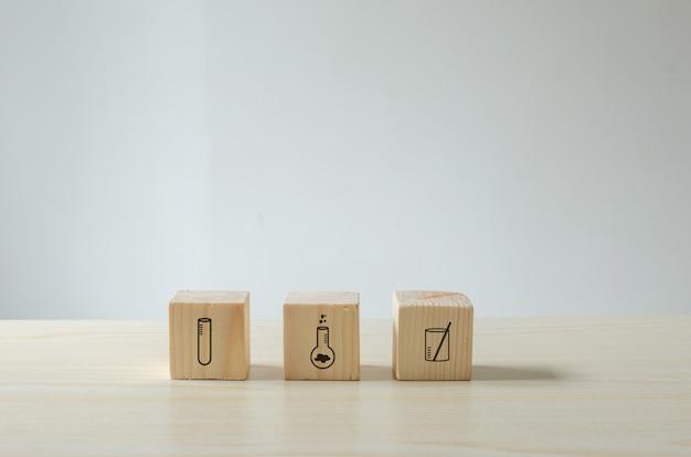 Кубики исследования и научная лаборатория чашки иконки. научное понятие