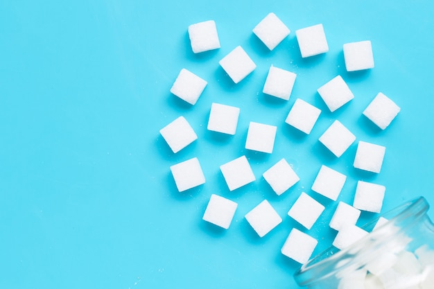 Cubes of sugar on a blue background.