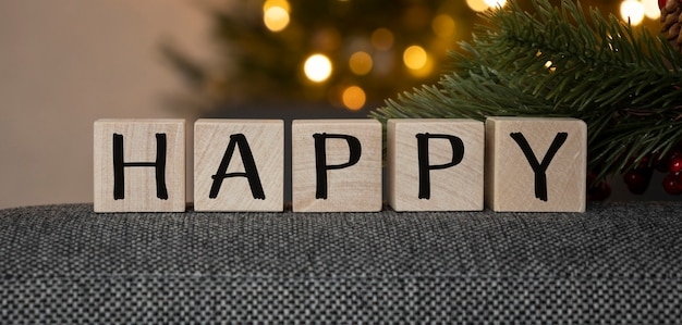 Cubes with the word happy. beautiful christmas background. business concept. copy space.