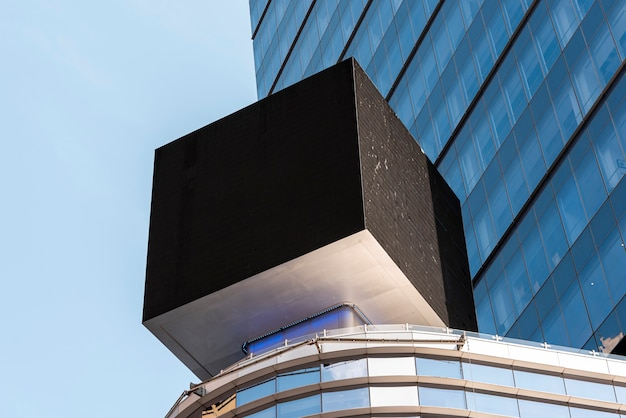 Cubic mock-up billboard in city scape