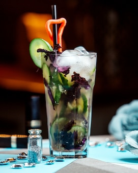Cucumber cocktail glass with red basil and ice