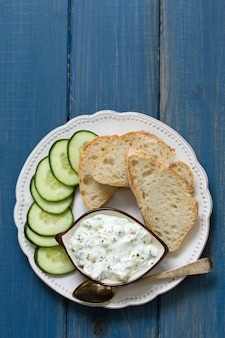 Cucumber dip with bread on plate