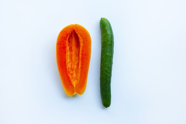 Cucumber and papaya  on white background. sex concept.