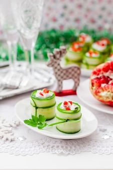 Cucumber rolls stuffed with feta cheese, herbs, capsicum and black olives