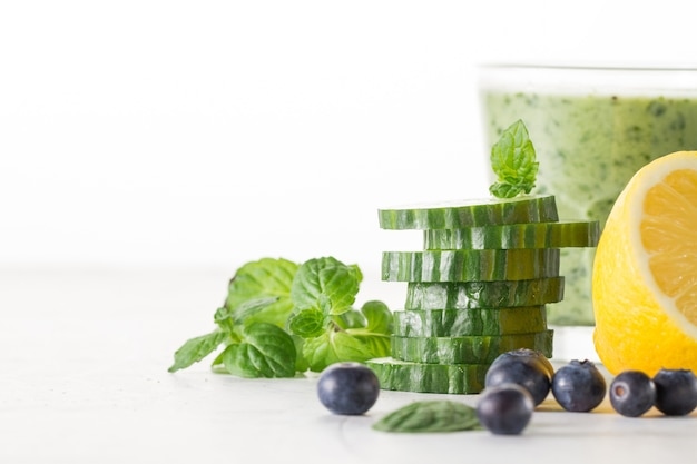 Cucumber slices in front of smoothie