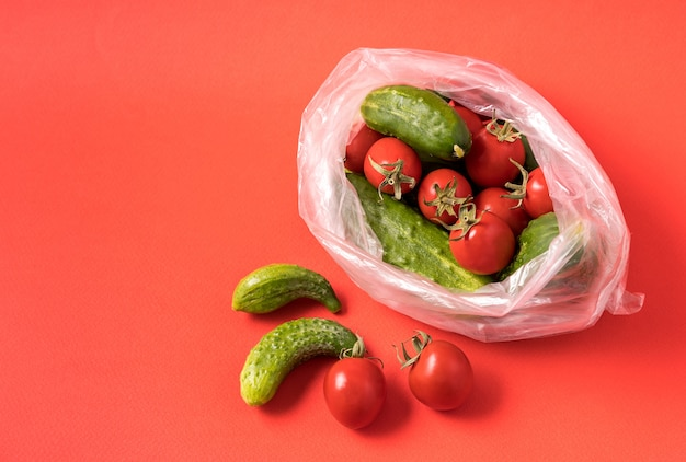 Cucumbers and tomatoes in plastic bag