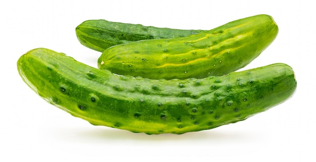 Cucumbers, whole, raw and fresh with drops of water.