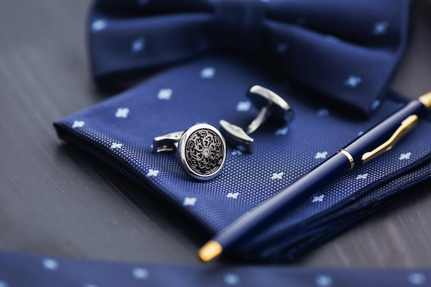Cufflink, pocket square and pen.