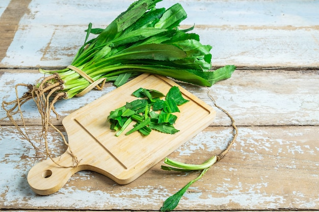 Culantro herbs on a wooden cutting board