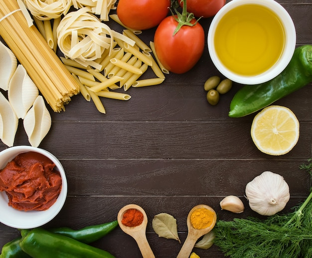 Culinary background for recipes. frame from ingredients for cooking italian pasta. grocery shopping list, recipe book, diet or vegan food.
