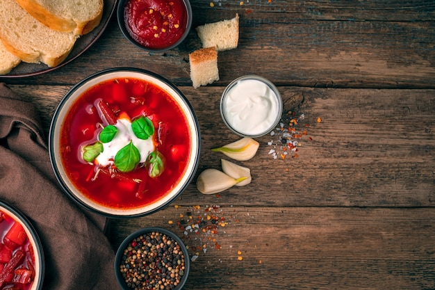 Culinary background with russian borscht on a wooden background. top view with copy space. cooking concept.