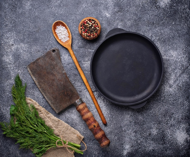 Culinary background with spices, pan and cleaver