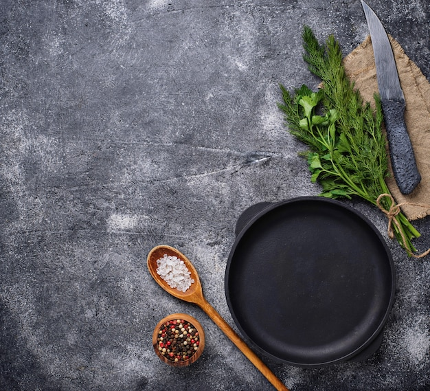 Culinary background with spices, pan and knife