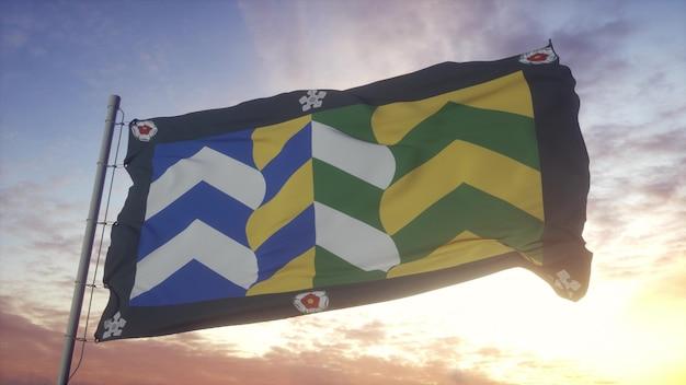カンブリアの旗、イギリス、風、空、太陽の背景に手を振っています。 3dレンダリング。