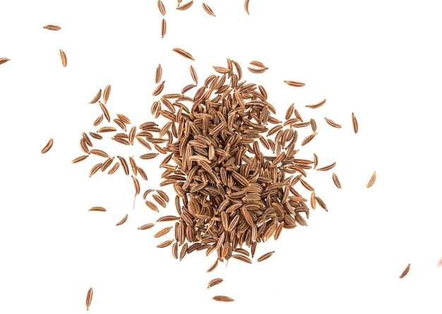 Cumin seeds or caraway isolated on white