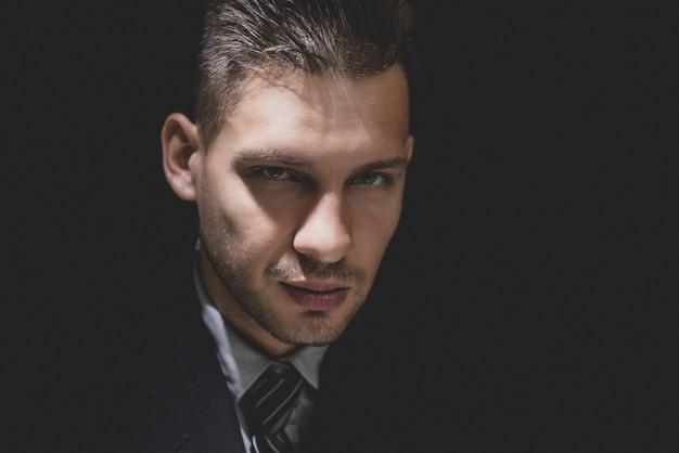 Cunning sly man face in dark room