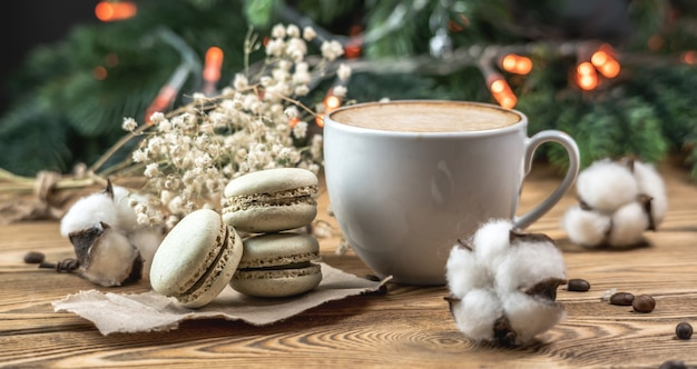 Cup of aromatic coffee and macaroons