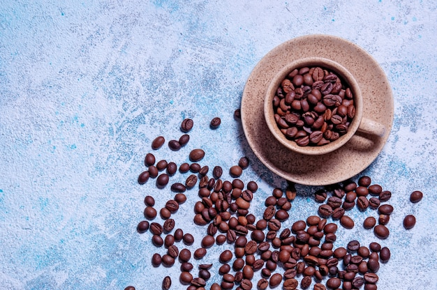 Cup of aromatic coffee with grains. top view flat lay..
