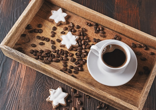 Cup of black coffee and coffee beans in wooden box. christmas concept.