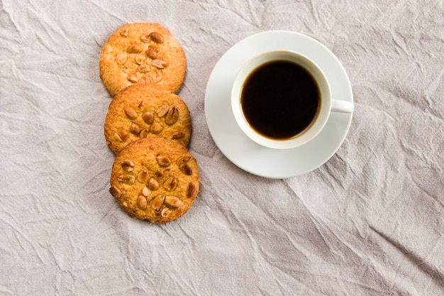 Cup of black coffee and cookies