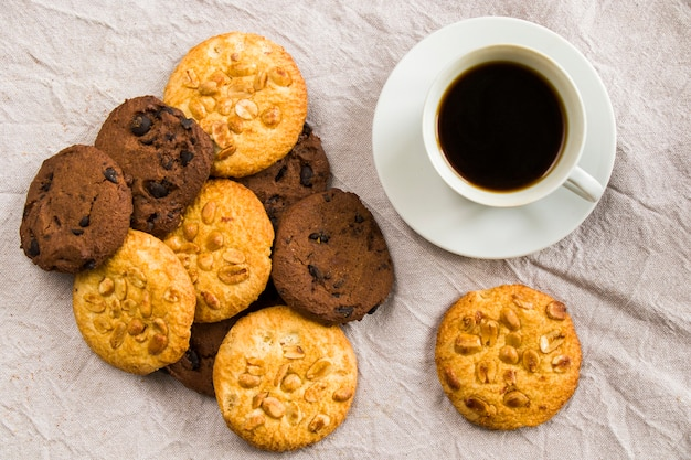 Cup of black coffee and cookies Premium Photo