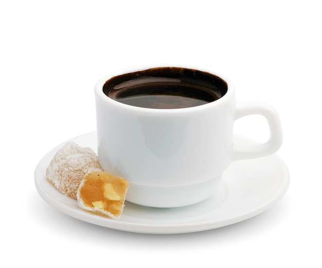 Cup of black coffee with turkish delight. isolated