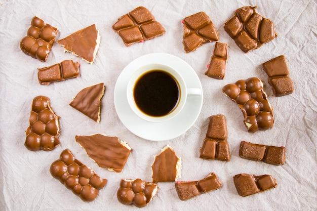 Cup of black espresso coffee and chocolate bars Premium Photo