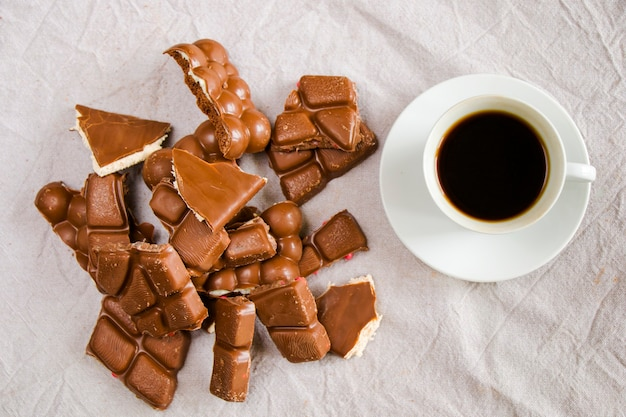 Cup of black espresso coffee and chocolate bars