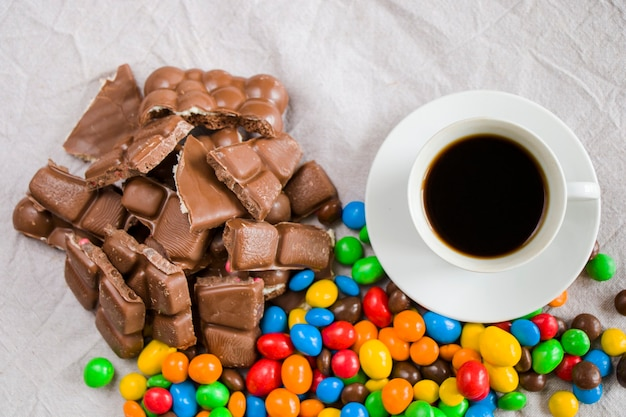 Cup of black espresso coffee and chocolate