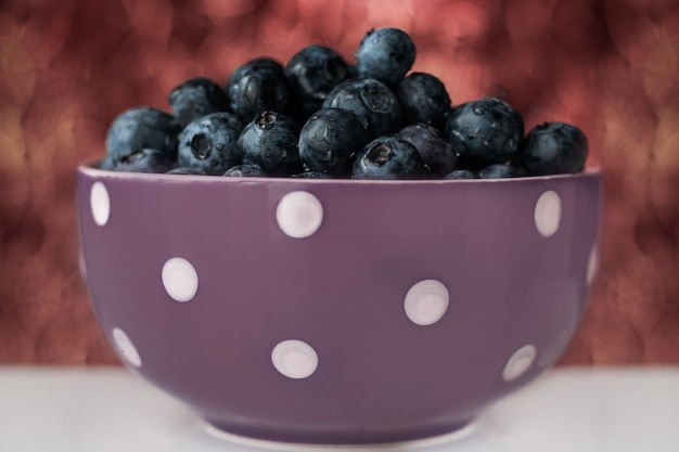 A cup of blueberries viewed from the top