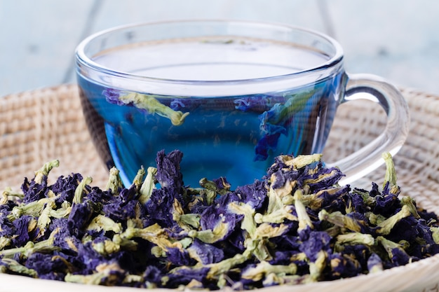 Cup of butterfly pea tea (pea flowers, blue pea)