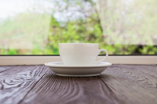 Cup for coffee against a window