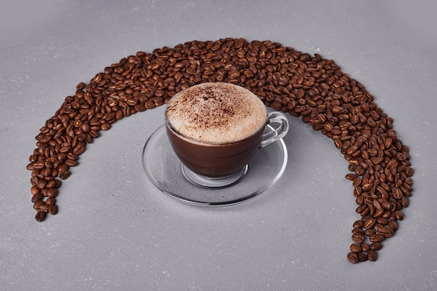 A cup of coffee on arabica beans.