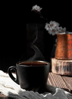 Cup of coffee of aromatic espresso on a wooden surface