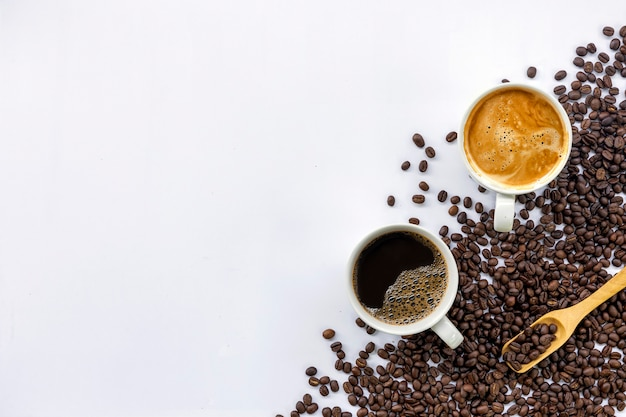 Cup of coffee and bean on white table