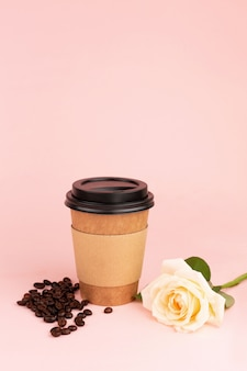 Cup, coffee beans and rose