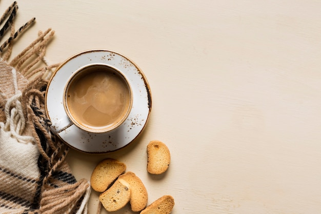 Cup of coffee on beige background with copy space