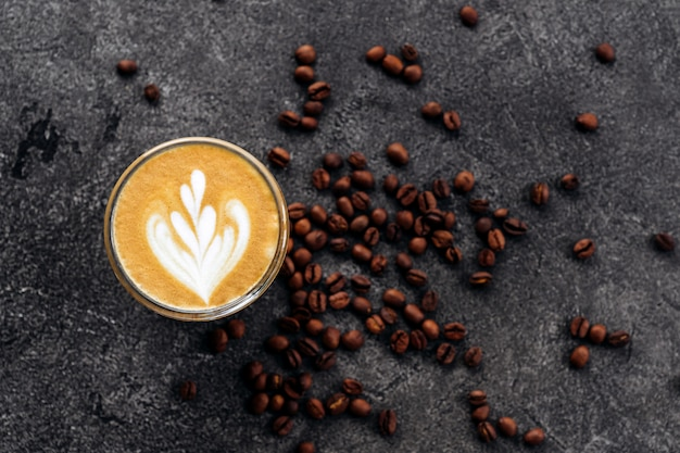 Cup of coffee on black stone background