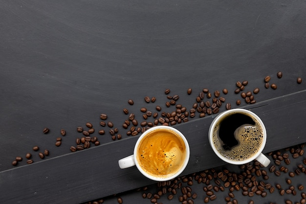 Cup of coffee on black wooden floor background