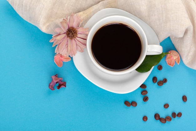 Cup of coffee on a blue table