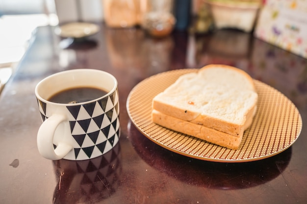 Cup of coffee and bread on the table