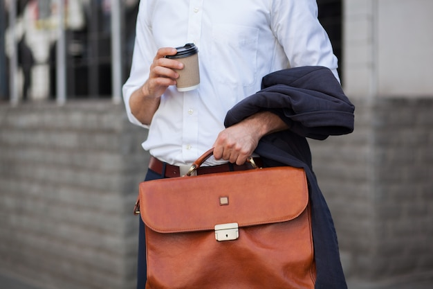 Cup of coffee and briefcase closeup shot