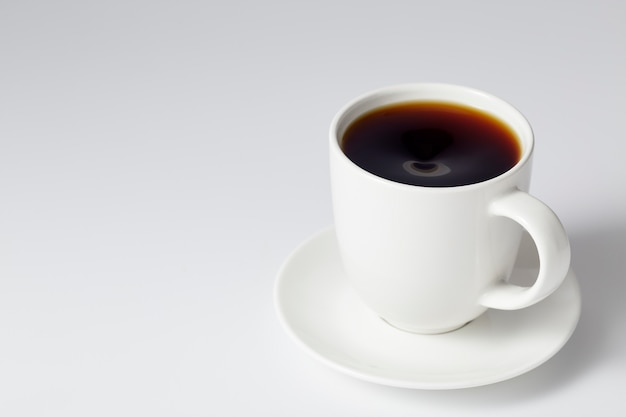 Cup of coffee on bright gray background